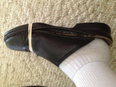 Good old childhood quick fix ... rubber bands around soles!  Just doesn't work with this style shoe!